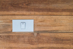White switch on wooden wall Royalty Free Stock Photography