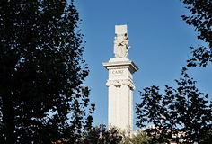 White symbolic column in Cadiz, southern Spain as a memorial and symbol of Spanish freedom Stock Images
