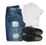 White t-shirt, blue boyfriend jeans and black textile shoes Royalty Free Stock Image