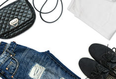 White t-shirt, blue boyfriend jeans, bag and black textile shoes Royalty Free Stock Photography