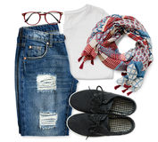 White t-shirt, blue boyfriend jeans, red glasses, scarf and black textile shoes stock photography