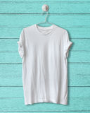 White t-shirt. Hang on blue wood vintage background royalty free stock photography