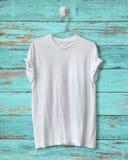 White t-shirt. Hang on blue wood vintage background stock photo
