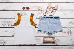 White t-shirt and shorts with accessories. Royalty Free Stock Image