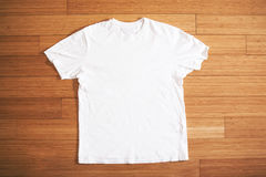 White t shirt on wood floor, mock up, free space royalty free stock images