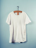 White T-shirt and wooden hanger Stock Images