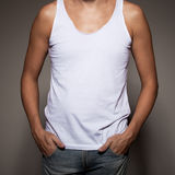 White t-shirt on a young man. Template on gray background Royalty Free Stock Image