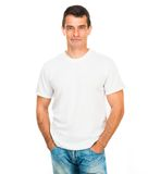 White t shirt on a young man. White t-shirt on a young man isolated Royalty Free Stock Photos