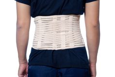 A man wear back support belt. White t-shirt on a young man isolated on white background royalty free stock photo