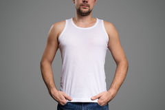 White t-shirt on a young man template. Gray background. Stock Photography