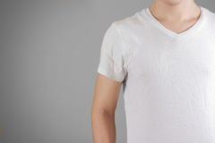 White t shirt on a young man template on gray. Isolated on grey. Background Royalty Free Stock Image