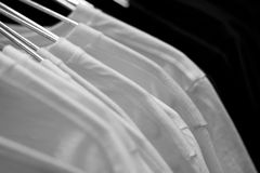 White t-shirts on cloth hangers Royalty Free Stock Photo