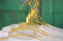 White t shirts on cloth hangers in row Royalty Free Stock Photos