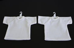 White t-shirts with coat hanger isolated Royalty Free Stock Image