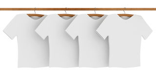 White T-shirts on Coat Hangers Royalty Free Stock Photos