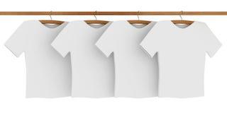 White T-shirts on Coat Hangers Royalty Free Stock Photos