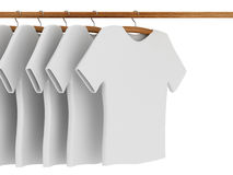 White T-shirts on Coat Hangers Royalty Free Stock Images