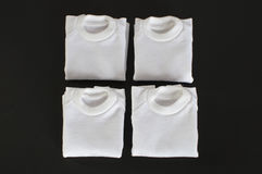 White t-shirts folded isolated Stock Photo