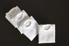 White T-shirts Folded Isolated Royalty Free Stock Image