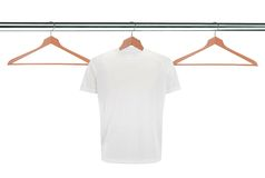 White t-shirts on hangers isolated on white Royalty Free Stock Photography