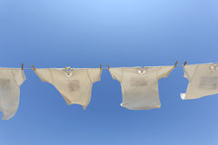 White t-shirts hanging to dry Stock Photography