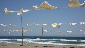 White t-shirts hanging to dry stock video footage