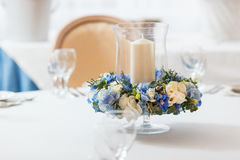 White table blue flowers candle decoration. White table candle blue flowers  arrangement decoration interior Stock Photography