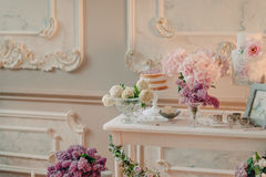 White table with bouquets of flowers royalty free stock images