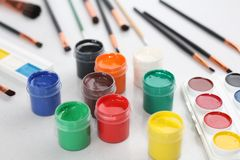 On a white table are brushes, watercolor paints and gouache royalty free illustration