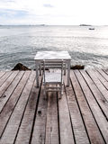 White table and chair on the beach 1 Stock Image