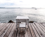 White table and chair on the beach 2 Royalty Free Stock Photography