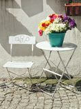 White table and chair with colorful flowers from izmir Turkey. White table chair with colrful colorful flowers fro izm izmi izmir tur turk turke turkey stock image