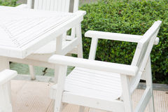 White table and chair in garden Stock Image