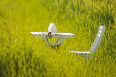 White Table and Chair in Grass Stock Photos