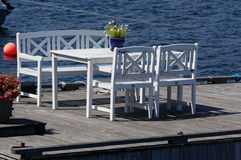 White table and chairs on the dock, Norway Royalty Free Stock Images