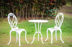 White table and chairs  in a garden Stock Photos
