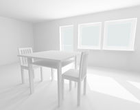 White table and chairs in room Stock Photography