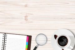 White table with coffee cup notebook Magnifying glass Royalty Free Stock Photos
