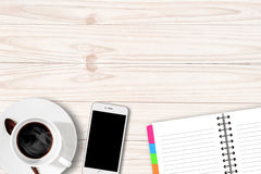 White table with coffee cup notebook and Smartphone Stock Photo