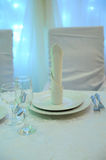 White table decor for the newlyweds in the restaurant. Backlight. Heart drapery Royalty Free Stock Photo