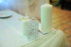 White table decor for the newlyweds in the restaurant. Backlight. Heart drapery Stock Photography