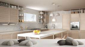 White table, desk or shelf with five soft white pillows in the shape of stars or flowers, over blurred modern wooden kitchen,. White architecture interior vector illustration