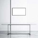 White table and empty TV screen. Bright interior with white table and empty TV screen Royalty Free Stock Photo