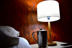White table lamp. In brown designed background with shadows Stock Images