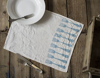 White Table Napkin with Blue Fork Pattern Design Stock Images