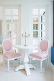 White table and pink chair with candle on table in living room Royalty Free Stock Photography