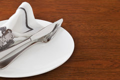 White Table Setting on Dark Oak Stock Photo