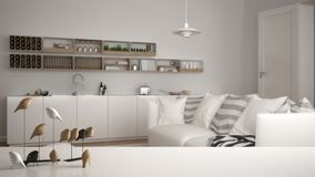 White table top or shelf with minimalistic bird ornament, birdie knick - knack over blurred contemporary living room with kitchen,. Modern interior design royalty free illustration