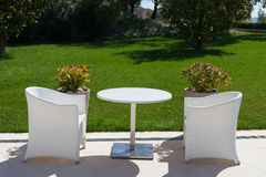 White table and two chairs outdoors Stock Photo