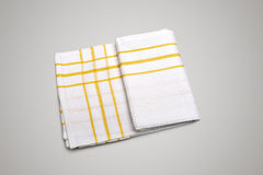 White Tablecloth made of cotton with yellow stripes for the dish Royalty Free Stock Images